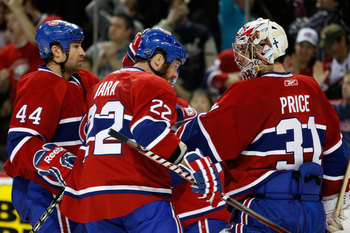 MONTREAL, CANADA - MARCH 8:  Members of the Montreal Canadiens celebrate the 4-1 victory over the Boston Bruins during the NHL game at the Bell Centre on March 8, 2011 in Montreal, Quebec, Canada.  (Photo by Richard Wolowicz/Getty Images)