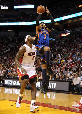 MIAMI, FL - FEBRUARY 27:  Carmelo Anthony #7 of the New York Knicks shoots around LeBron James #6 of the Miami Heat during a game at American Airlines Arena on February 27, 2011 in Miami, Florida. NOTE TO USER: User expressly acknowledges and agrees that,