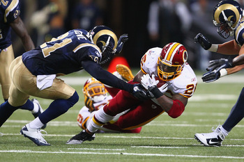 ST. LOUIS - SEPTEMBER 26: Clinton Portis #26 of the Washington Redskins is tackled against the St. Louis Rams at the Edward Jones Dome on September 26, 2010 in St. Louis, Missouri.  The Rams beat the Redskins 30-16.  (Photo by Dilip Vishwanat/Getty Images