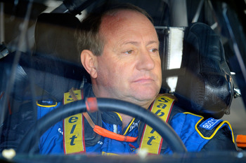 MARTINSVILLE, VA - OCTOBER 22:  Ken Schrader, driver of the #26 Air Guard Chevrolet, sits in his car during practice for the NASCAR Sprint Cup Series TUMS Fast Relief 500 at Martinsville Speedway on October 22, 2010 in Martinsville, Virginia.  (Photo by J