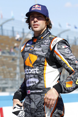 AVONDALE, AZ - FEBRUARY 24:  Travis Pastrana, driver of the #99 Boost Mobile Toyota, waits on pit road during qualifying for the NASCAR K&N Pro Series West 3 Amigos Organic Blanco 100 at Phoenix International Raceway on February 24, 2011 in Avondale, Ariz