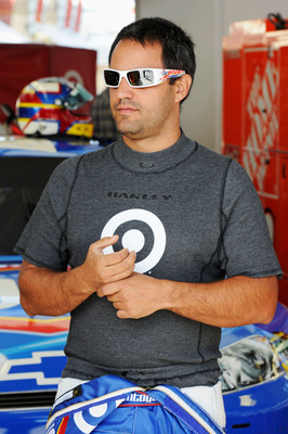 LAS VEGAS, NV - MARCH 05:  Juan Pablo Montoya, driver of the #42 Clorox Chevrolet, walks in the garage during practice for the NASCAR Sprint Cup Series Kobalt Tools 400 at Las Vegas Motor Speedway on March 5, 2011 in Las Vegas, Nevada.  (Photo by John Har