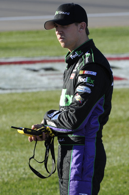 LAS VEGAS, NV - MARCH 04:  Denny Hamlin, driver of the #11 FedEx Ground Toyota, waits on the grid during qualifying for the NASCAR Sprint Cup Series Kobalt Tools 400 at Las Vegas Motor Speedway on March 4, 2011 in Las Vegas, Nevada.  (Photo by John Harrel