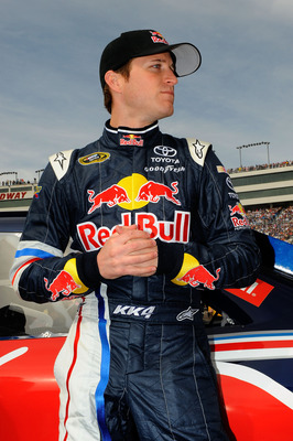 LAS VEGAS, NV - MARCH 06:  Kasey Kahne, driver of the #4 Red Bull Toyota, stands next to his car on the grid prior to the NASCAR Sprint Cup Series Kobalt Tools 400 at Las Vegas Motor Speedway on March 6, 2011 in Las Vegas, Nevada.  (Photo by Jared C. Tilt