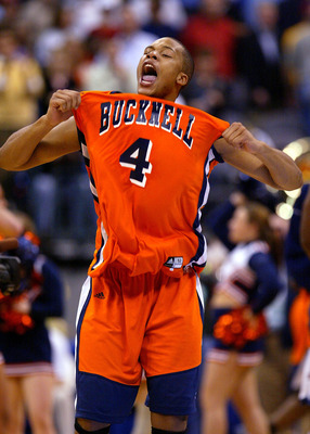 OKLAHOMA CITY - MARCH 18:  Donald Young #4 of the Bucknell Bison screams as his team upset the Kansas Jayhawks during the first round of the NCAA Men's Basketball Championship on March 18, 2005 at the Ford Center in Oklahoma City, Oklahoma. Bucknell knock