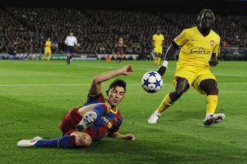 BARCELONA, SPAIN - MARCH 08:  David Villa of FC Barcelona (L) fights for the ball against Bacary Sagna of Arsenal during the UEFA Champions League round of 16 second leg match between Barcelona and Arsenal at the Camp Nou stadium on March 8, 2011 in Barce