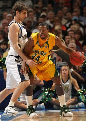 DENVER - MARCH 20:  Will Thomas #34 of the George Mason Patriots handles the ball against the Notre Dame Fighting Irish during the first round of the East Regional as part of the 2008 NCAA Men's Basketball Tournament at Pepsi Center on March 20, 2008 in D
