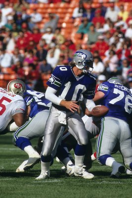 SAN FRANCISCO, CA - AUGUST 28:  Quarterback Dan McGwire #10 of the Seattle Seahawks looks to hand off the ball during the exhibition game against the San Francisco 49ers at Candlestick Park on August 28, 1992 in San Francisco, California.  The 49ers won 2