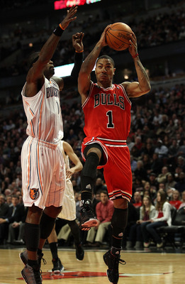 CHICAGO, IL - FEBRUARY 15: Derrick Rose #1 of the Chicago Bulls drives past Stephen Jackson #1 of the Charlotte Bobcats at the United Center on February 15, 2011 in Chicago, Illinois. The Bulls defeated the Bobcats 106-94. NOTE TO USER: User expressly ack