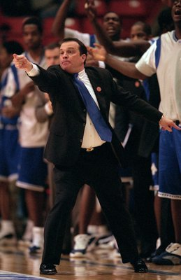 15 Mar 2001:  Head Coach Steve Merfeld of the Hampton Pirates pionts from the sidelines during the game against the Iowa State Cyclones at the Boise State Pavilion in Boise, Idaho. The Pirates defeated the Cyclones 58-57.Mandatory Credit: Brian Bahr  /All