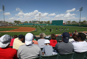 TUCSON, AZ - MARCH 07:  Fans watch the Chicago White Sox warm up before the spring training game against the Arizona Diamondbacks at Kino Veterans Memorial Stadium on March 7, 2011 in Tucson, Arizona. The charity game is to benefit the 9-year-old Christin