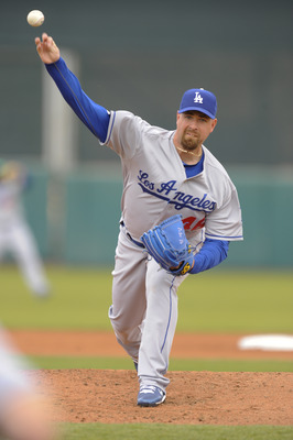 SCOTTSDALE, AZ - FEBRUARY 26: Tim Redding #46 of the Los Angeles Dodgers pitches during a spring training game against the San Francisco Giants at Scottsdale Stadium on February 26, 2011 in Scottsdale, Arizona. (Photo by Rob Tringali/Getty Images)
