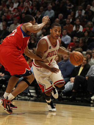 CHICAGO, IL - DECEMBER 21: Derrick Rose #1 of the Chicago Bulls moves against Evan Turner #12 of the Philadelphia 76ers at the United Center on December 21, 2010 in Chicago, Illinois. The Bulls defeated the 76ers 121-76. NOTE TO USER: User expressly ackno