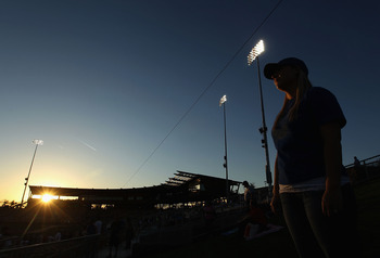 GLENDALE, AZ - MARCH 04:  A fan of the Los Angeles Dodgers stands in the outfield before the spring training game against the San Francisco Giants at Camelback Ranch on March 4, 2011 in Glendale, Arizona.  (Photo by Christian Petersen/Getty Images)