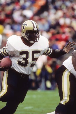 SAN FRANCISCO - SEPTEMBER 29:  Running back Earl Campbell #35 of the New Orleans Saints looks for room to run against the San Francisco 49ers defense during a game at Candlestick Park on September 29, 1985 in San Francisco, California.  The Saints won 20-