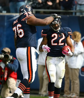 CHICAGO - OCTOBER 04: Matt Forte #22 of the Chicago Bears is congratulated by teammate Orlando Pace #76 after scoring a touchdown against the Detroit Lions on October 4, 2009 at Soldier Field in Chicago, Illinois. The Bears defeated the Lions 48-24.  (Pho