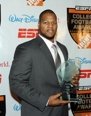 LAKE BUENA VISTA, FL - DECEMBER 10:  Defensive lineman Ndamukong Suh of the Nebraska Cornhuskers poses with the Chuck Bednarik Award trophy during the Home Depot ESPNU College Football Awards at the Disney Boardwalk on December 10, 2009 in Lake Buena Vist