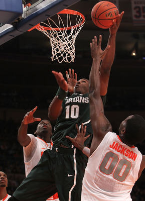NEW YORK, NY - DECEMBER 07: Delvon Roe #10 of the Michigan Spartans shoots the ball under pressure from Rick Jackson #00 of Syracuse Orange during their game at the Jimmy V Classic at Madison Square Garden on December 7, 2010 in New York City.  (Photo by