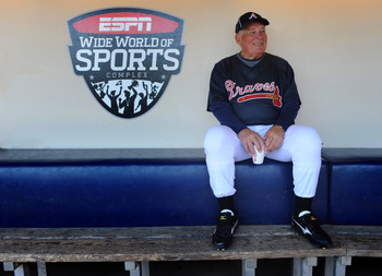 LAKE BUENA VISTA, FL - MARCH 31:  In this handout photo provided by Disney, Atlanta Braves manager Bobby Cox sits in the dugout at ESPN Wide World of Sports Complex prior to the start of his final game at the complex's baseball stadium on March 31, 2010 i