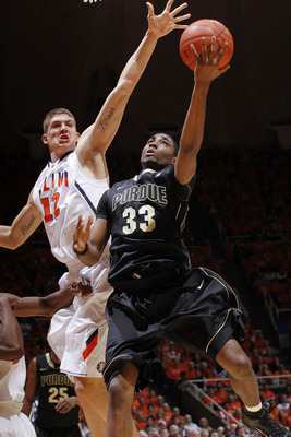 CHAMPAIGN, IL - FEBRUARY 13: E'Twaun Moore #33 of the Purdue Boilermakers goes to the basket past Meyers Leonard #12 of the Illinois Fighting Illini at Assembly Hall on February 13, 2011 in Champaign, Illinois. Purdue defeated Illinois 81-70. (Photo by Jo