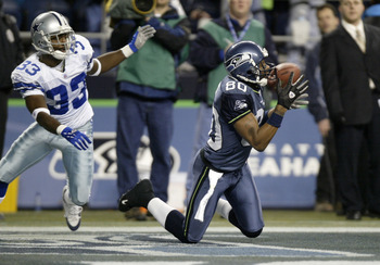 SEATTLE - DECEMBER 6:  Wide receiver Jerry Rice #80 of the Seattle Seahawks makes a 27 yard touchdown catch in the first quarter against Nathan Jones #33 of the Dallas Cowboys on December 6, 2004 at Qwest Field in Seattle, Washington. The catch moved Rice