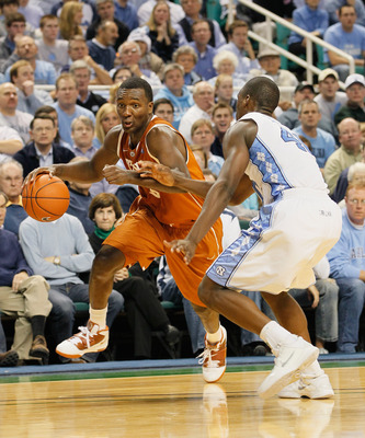 GREENSBORO, NC - DECEMBER 18:  Jordan Hamilton #3 of the Texas Longhorns against Harrison Barnes #40 of the North Carolina Tar Heels at Greensboro Coliseum on December 18, 2010 in Greensboro, North Carolina.  (Photo by Kevin C. Cox/Getty Images)