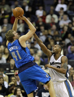WASHINGTON, DC - FEBRUARY 26: Dirk Nowitzki #41 of the Dallas Mavericks puts up a shot in front of Rashard Lewis #9 of the Washington Wizards at the Verizon Center on February 26, 2011 in Washington, DC. NOTE TO USER: User expressly acknowledges and agree