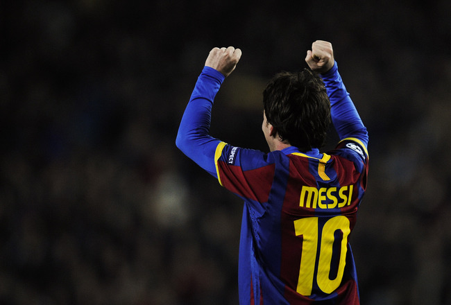 BARCELONA, SPAIN - MARCH 08:  Lionel Messi of FC Barcelona celebrates after scoring his second goal during the UEFA Champions League round of 16 second leg match between Barcelona and Arsenal at the Camp Nou stadium on March 8, 2011 in Barcelona, Spain.