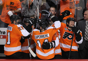 PHILADELPHIA - JUNE 09:  The Philadelphia Flyers bench celebrates after teammate Scott Hartnell #19 scored a goal in the third period against the Chicago Blackhawks in Game Six of the 2010 NHL Stanley Cup Final at the Wachovia Center on June 9, 2010 in Ph
