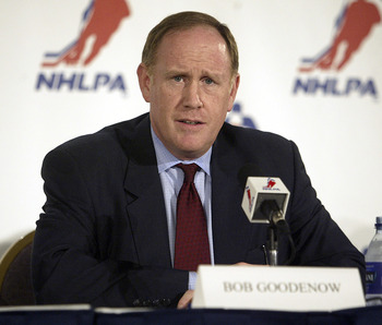 TORONTO - JULY 21:  NHLPA Executive Director Bob Goodenow answers a question during a press conference announcing the NHLPA's ratification of the new collective bargaining agreement in a Toronto hotel on July 21, 2005 in Toronto, Canada.  (Photo by Tom Pi