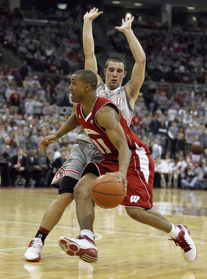 COLUMBUS, OH - MARCH 06:  Jordan Taylor #11 of the Wisconsin Badgers drives around Aaron Craft #4 of the Ohio State Buckeyes on March 6, 2011 at the Value City Arena in Columbus, Ohio. Ohio State won the game 93-65.  (Photo by Gregory Shamus/Getty Images)