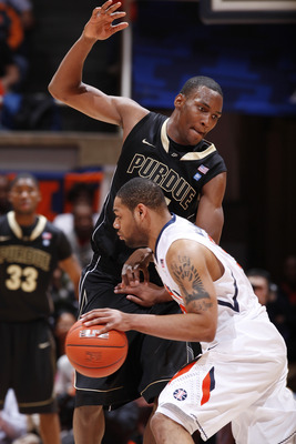 CHAMPAIGN, IL - FEBRUARY 13: JaJuan Johnson #25 of the Purdue Boilermakers defends against Demetri McCamey #32 of the Illinois Fighting Illini at Assembly Hall on February 13, 2011 in Champaign, Illinois. Purdue defeated Illinois 81-70. (Photo by Joe Robb
