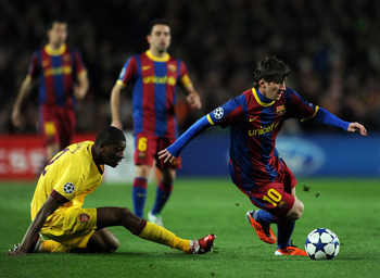 BARCELONA, SPAIN - MARCH 08:  Abou Diaby (L) of Arsenal fails to stop Lionel Messi of Barcelona during the UEFA Champions League round of 16 second leg match between Barcelona and Arsenal on March 8, 2011 in Barcelona, Spain.  (Photo by Jasper Juinen/Gett