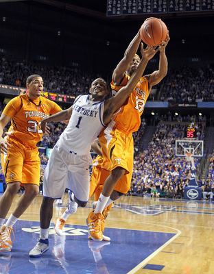 LEXINGTON, KY - FEBRUARY 08:  Darius Miller #1 of the Kentucky Wildcats and Cameron Tatum #23 of the Tennessee Volunteers reach for a rebound during the SEC game at Rupp Arena on February 8, 2011 in Lexington, Kentucky. Kentucky won 73-61.  (Photo by Andy