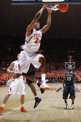 CHAMPAIGN, IL - FEBRUARY 13: Mike Davis #24 of the Illinois Fighting Illini dunks the ball against the Purdue Boilermakers at Assembly Hall on February 13, 2011 in Champaign, Illinois. Purdue defeated Illinois 81-70. (Photo by Joe Robbins/Getty Images)