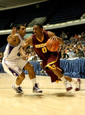 ANAHEIM, CA - NOVEMBER 27:  Al Nolen #0 of the Minnesota Gophers drives against T.J. Campbell  #44 of the Portland Pilots at the 76 Classic at Anaheim Convention Center on November 27, 2009 in Anaheim, California.  (Photo by Stephen Dunn/Getty Images)