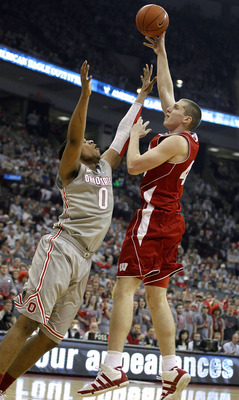 COLUMBUS, OH - MARCH 06: Jared Berggren #40 of the Wisconsin Badgers shoots over Jared Sullinger #0 of the Ohio State Buckeyeson March 6, 2011 at the Value City Arena in Columbus, Ohio. Ohio State won the game 93-65. (Photo by Gregory Shamus/Getty Images)