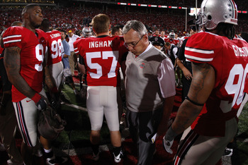 COLUMBUS, OH - SEPTEMBER 12: Head coach Jim Tressel of the Ohio State Buckeyes leaves the field after losing 18-15 to the Southern California Trojans on September 12, 2009 at Ohio Stadium in Columbus, Ohio.  (Photo by Gregory Shamus/Getty Images)