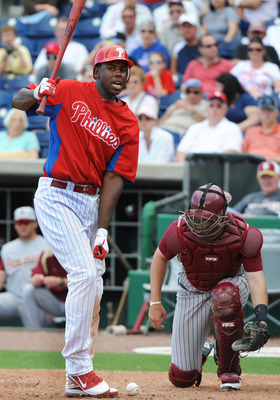 CLEARWATER, FL - FEBRUARY 24:  Outfielder John Mayberry Jr. #15 of the Philadelphia Phillies turns after he is hit by an inside pitch against the Florida State Seminoles February 24, 2011 at Bright House Field in Clearwater, Florida.  (Photo by Al Messers