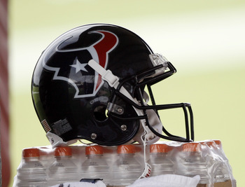 HOUSTON - JULY 31:  A Houston Texans helmet sits on a stack of Gatorade during practice on July 31, 2009 in Houston, Texas.  (Photo by Bob Levey/Getty Images)