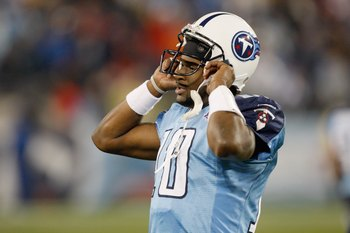 NASHVILLE, TN - NOVEMBER 29:  Quarterback Vince Young #10 of the Tennessee Titans puts on his helmet during the game against the Arizona Cardinals at LP Field on November 29, 2009 in Nashville, Tennessee. The Titans defeated the Cardinals 20-17. (Photo by
