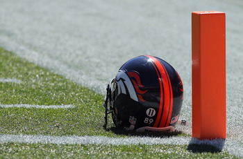 DENVER - SEPTEMBER 26:  The helmets of the Denver Broncos were adorned with the #11 of recently deceased teammate Kenny McKinley as they face the Indianapolis Colts at INVESCO Field at Mile High on September 26, 2010 in Denver, Colorado. The Colts defeate