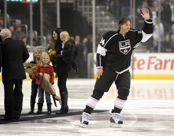 LOS ANGELES, CA - NOVEMBER 11:  Ryan Smyth #94 of the Los Angeles Kings is honored with his family for playing in his 1000th game before the game between the Dallas Stars at the Staples Center on November 11, 2010 in Los Angeles, California.  (Photo by Ha