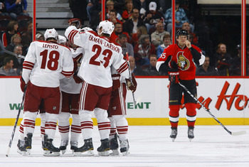 OTTAWA, ON - OCTOBER 26:  Sami Lepisto #18 of the Phoenix Coyotes celebrates his goal with his teammates while Sergei Gonchar #55 of the Ottawa Senators skates away dejectedly during a game at Scotiabank Place on October 26, 2010 in Ottawa, Ontario, Canad