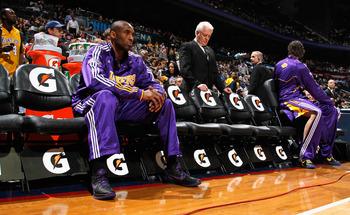 ATLANTA, GA - MARCH 08:  Kobe Bryant #24 of the Los Angeles Lakers waits for game introductions to face the Atlanta Hawks at Philips Arena on March 8, 2011 in Atlanta, Georgia.  NOTE TO USER: User expressly acknowledges and agrees that, by downloading and