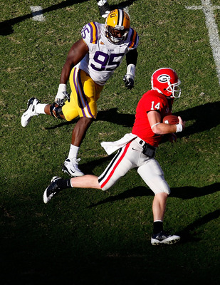 ATHENS, GA - OCTOBER 03:  Lazarius Levingston #95 of the Louisiana State University Tigers gives chase to quarterback Joe Cox #14 of the Georgia Bulldogs at Sanford Stadium on October 3, 2009 in Athens, Georgia. (Photo by Kevin C. Cox/Getty Images)