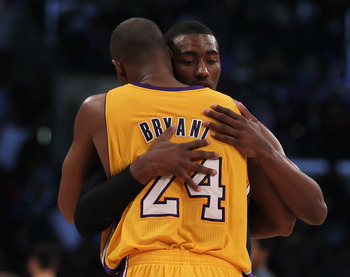 LOS ANGELES, CA - DECEMBER 07:  Kobe Bryant #24 of the Los Angeles Lakers and John Wall #2 of the Washington Wizards hug at the conclusion of the game at Staples Center on December 7, 2010 in Los Angeles, California. The Lakers defeated the Wizards 115-10