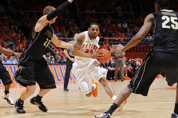 CHAMPAIGN, IL - FEBRUARY 13: Demetri McCamey #32 of the Illinois Fighting Illini goes to the basket against the Purdue Boilermakers at Assembly Hall on February 13, 2011 in Champaign, Illinois. Purdue defeated Illinois 81-70. (Photo by Joe Robbins/Getty I