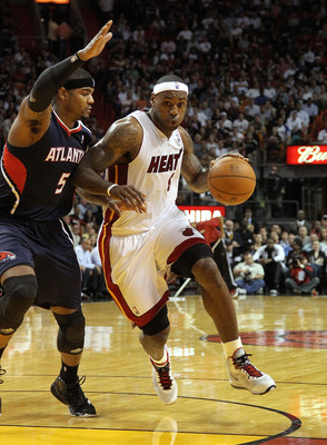 MIAMI, FL - JANUARY 18:  LeBron James #6 of the Miami Heat is guarded by Josh Smith #5 of the Atlanta Hawks during a game at American Airlines Arena on January 18, 2011 in Miami, Florida. NOTE TO USER: User expressly acknowledges and agrees that, by downl