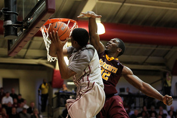 PHILADELPHIA, PA - DECEMBER 08:  Trevor Mbakwe #32 of the Minnesota Golden Gophers defends against Ronald Roberts Jr. #13 of the St. Joseph's Hawks at Michael J. Hagan Arena on December 8, 2010 in Philadelphia, Pennsylvania.  (Photo by Chris Chambers/Gett